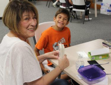 Volunteer - tutoring woman and boy